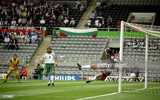 Dorinel Nunteanu of Romania sees his shot cross the line but the goal was disallowed during the European Championship match against Bulgaria at St...