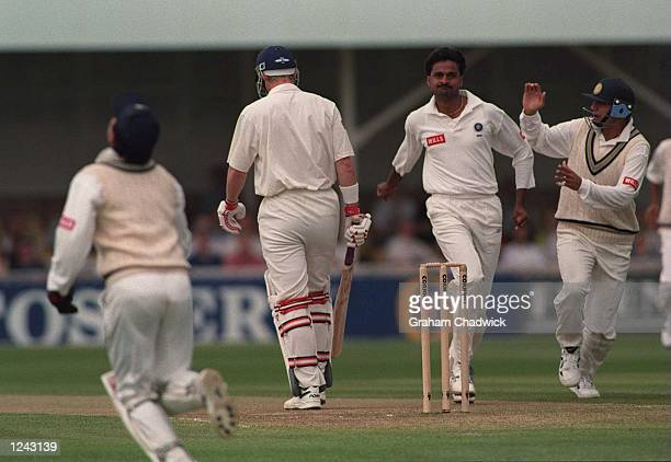 Javagal Srinath of India celebrates the wicket of Nick Knightof England caught by Mongia for 27 during the second days play in the First England v...