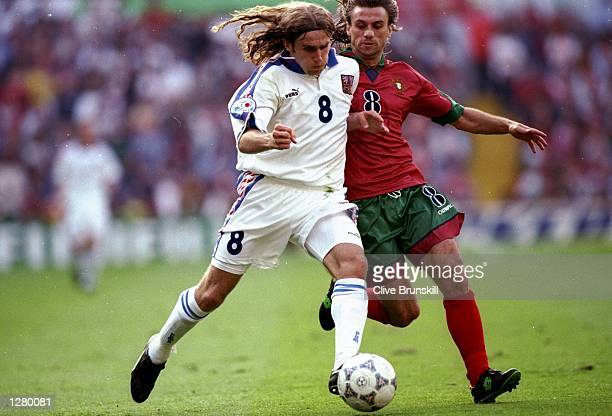Korel Poborsky of the Czech Republic takes on Joao Pinto of Portugal during the European Championship quarterfinal at Villa Park in Birmingham...