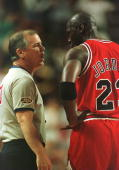 Michael Jordan of the Chicago Bulls argues with official Joe Crawford over a technical foul called on teammate Dennis Rodman during the first half of...