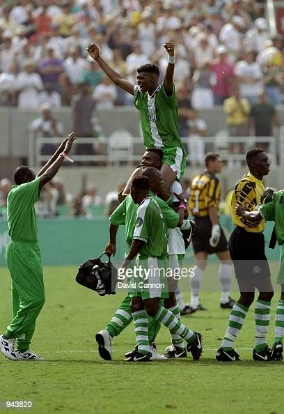 Nigeria Captain Nwankwo Kanu is carried by team mates after their victory in the Mens Football Final over Argentina at the Olympic Stadium during the...