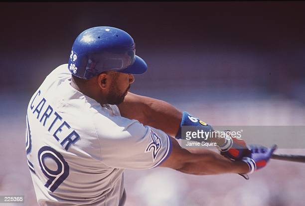 Outfielder Joe Carter of the Toronto Blue Jays focuses on the ball as he extends his arms after hitting the ball during an atbat in the Blue Jays 64...