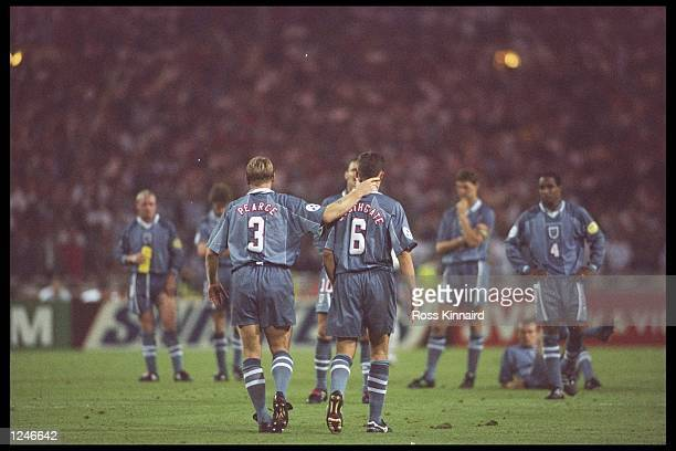 Stuart Pearce consoles teammate Gareth Southgate after his penalty miss during the European soccer championships semi final match between England and...