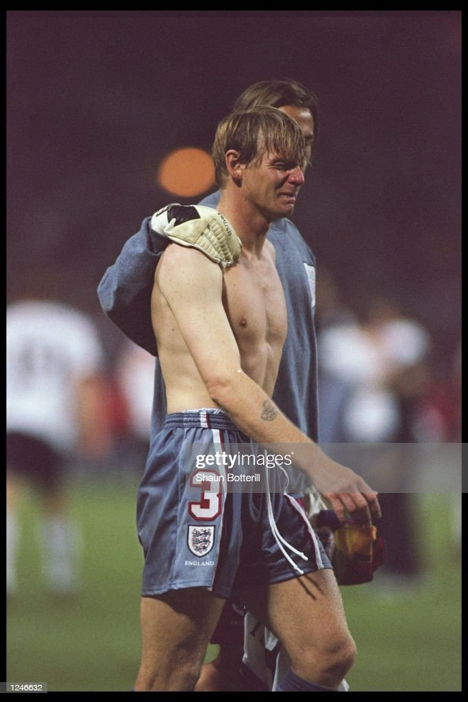 Stuart Pearce of England is consoled after England loose out to Germany again in a penalty shoot out during the European soccer championships semi final match between England and Germany at Wembley Stadium, London. Germany won the match after extra time in a penalty shoot out by 1(6) 1(5). Mandatory Credit: Shuan Botterill/Allsport UK