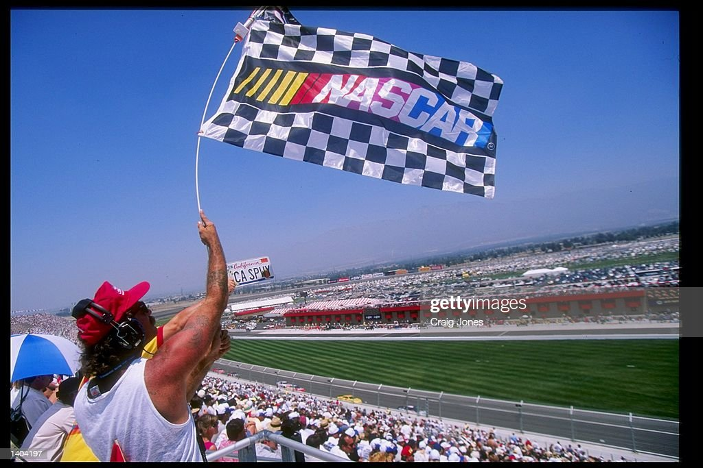 A fan waves the Nascar banner at the California 500 at the California Speedway in Fontana California Mandatory Credit Craig Jones /Allsport