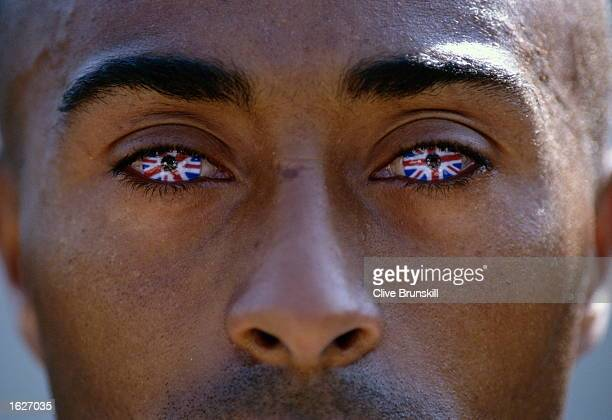 A portrait of Colin Jackson of Great Britain wearing Union Jack contact lenses at the World Championships held in the Olympic Stadium in Athens...