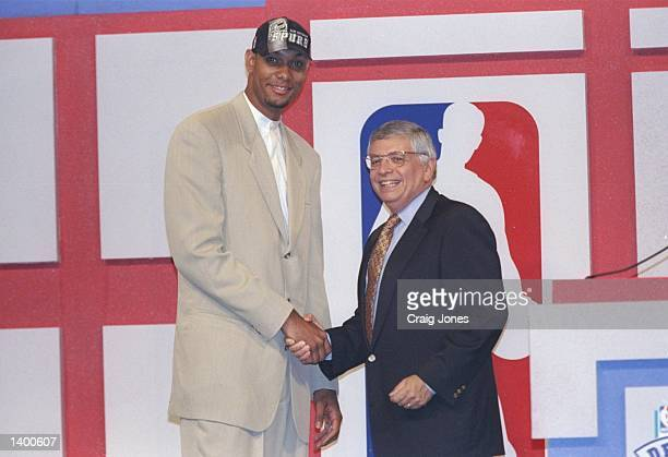 Center Tim Duncan of the San Antonio Spurs shakes hands with NBA Commissioner David Stern during the NBA Draft at the Charlotte Coliseum in Charlotte...
