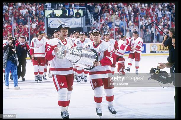 Detroit Red Wings center Igor Larionov and defenseman Vlacheslav Fetisov skates with the Stanley Cup at Joe Louis Arena in Detroit Michigan The Red...
