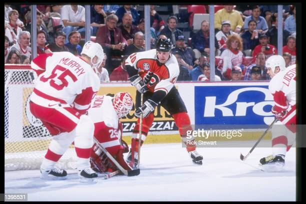 Detroit Red Wings goalie Mike Vernon makes a save on a shot from Philadelphia Flyers center John LeClair during the Stanley Cup Finals at Joe Louis...