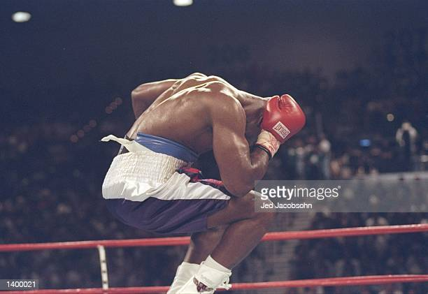 Evander Holyfield jumps in the air and holds his head in agony after Mike Tyson bit a piece off his right ear in the third round of their heavyweight...