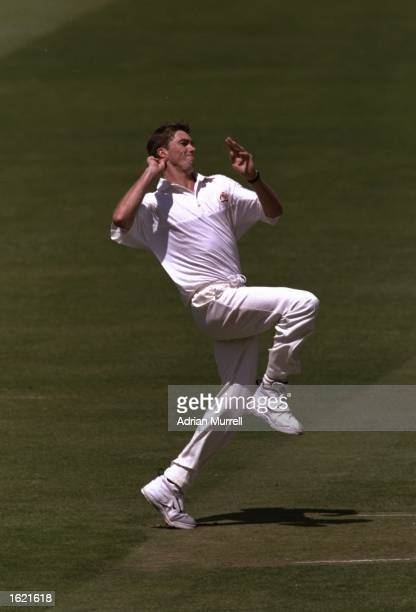 Glenn McGrath of Australia runs into bowl during the second test match against England at Lords Cricket Ground in London England The match ended in a...
