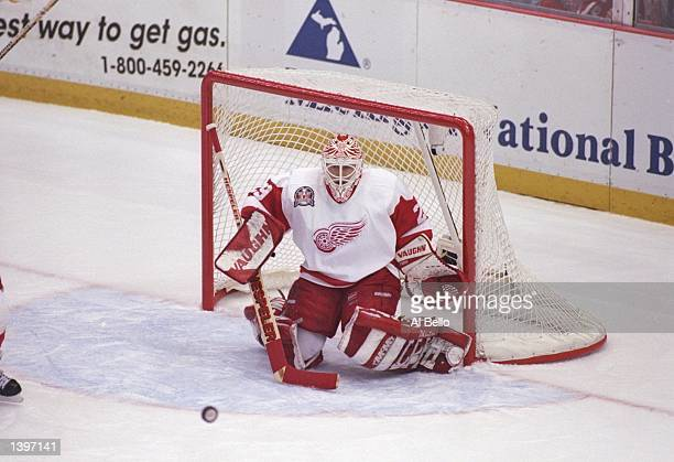 Goaltender Mike Vernon of the Detroit Red Wings tends goal during a playoff game against the Philadelphia Flyers at Joe Louis Arena in Detroit...