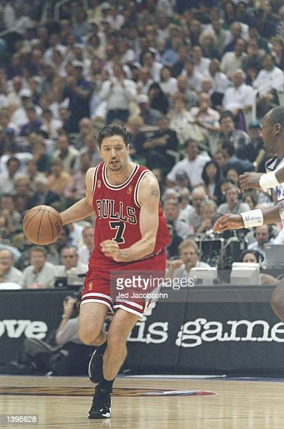 Guard Toni Kukoc of the Chicago Bulls dribbles the ball down the court during a playoff game against the Utah Jazz at the Delta Center in Salt Lake...