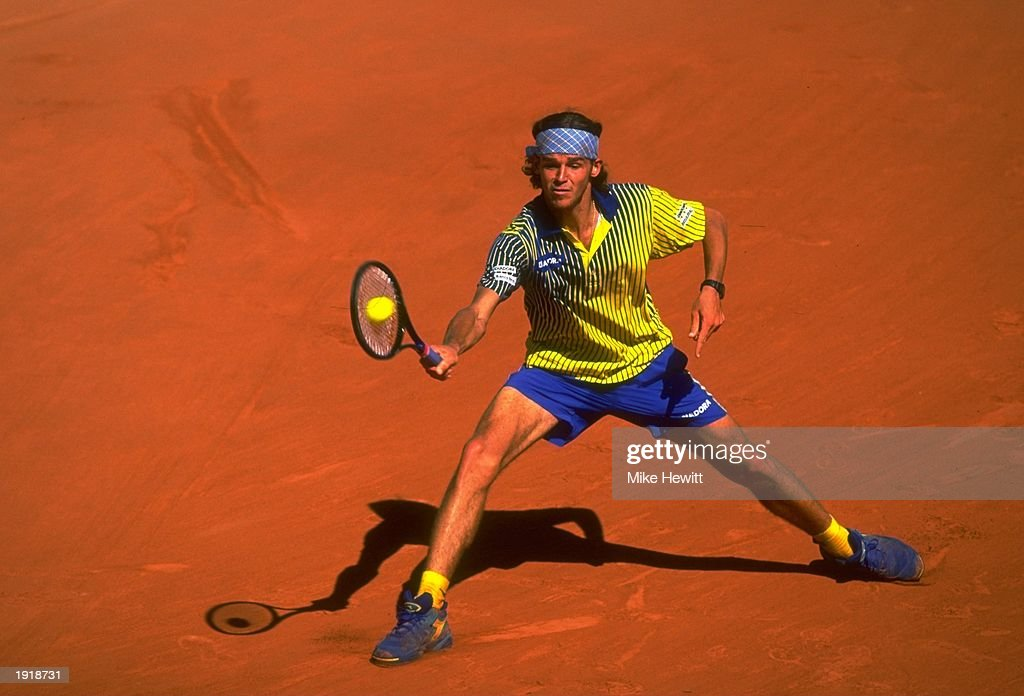 Gustavo Kuerten of Brazil stretches to return a shot during the final of the French Open against Sergi Bruguera of Spain at Roland Garros Stadium in Paris, France. Kuerten won the match. \ Mandatory Credit: Mike Hewitt /Allsport