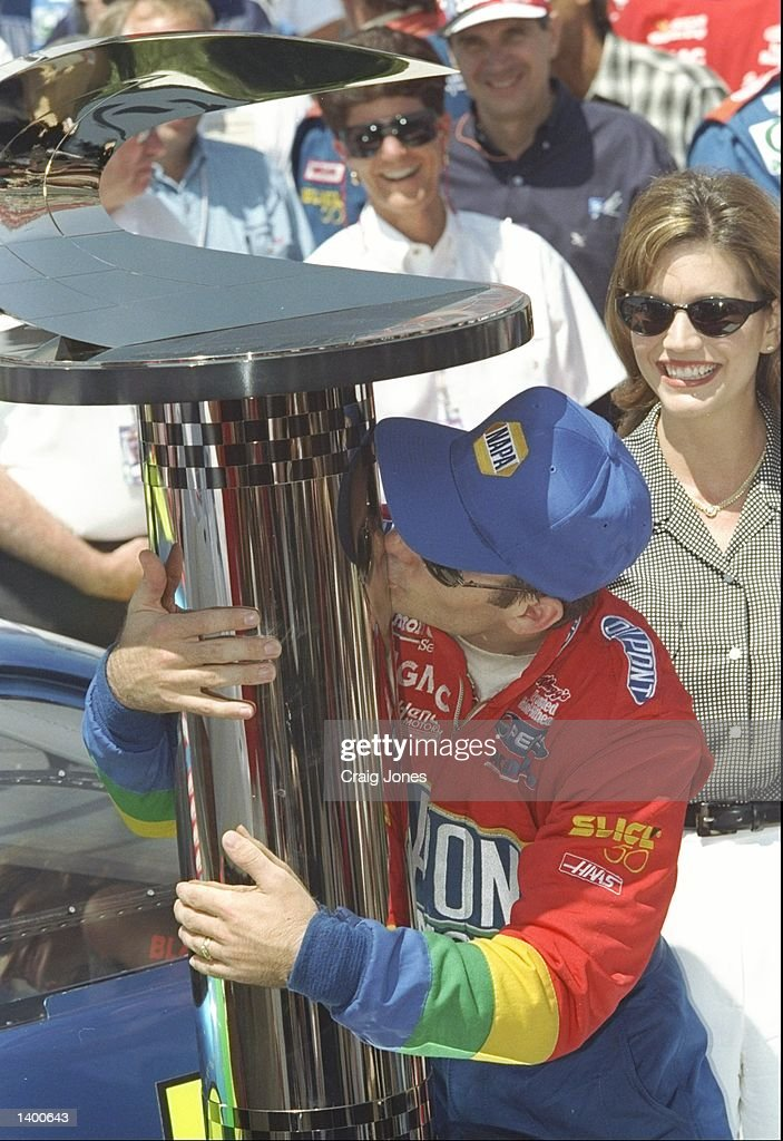Jeff Gordon kisses his trophy after winning the California 500 at the California Speedway in Fontana California Mandatory Credit Craig Jones /Allsport