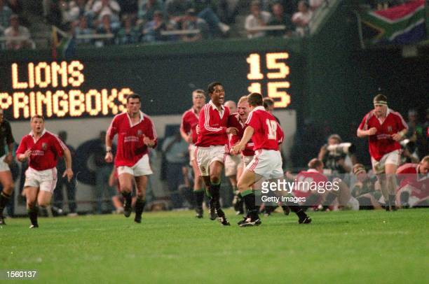 Jeremy Guscott of the British Lions celebrates kicking the winning drop goal against South Africa during the Second Test at Kings Park in Durban...