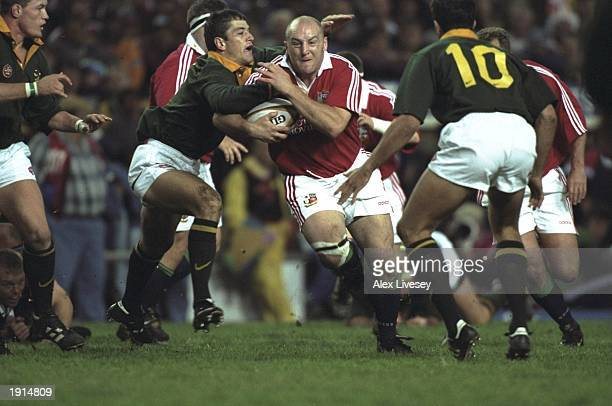 Keith Wood of the British Lions is tackled by Van Der Wethuizen of South Africa during the first test at Newlands in Cape Town South Africa British...