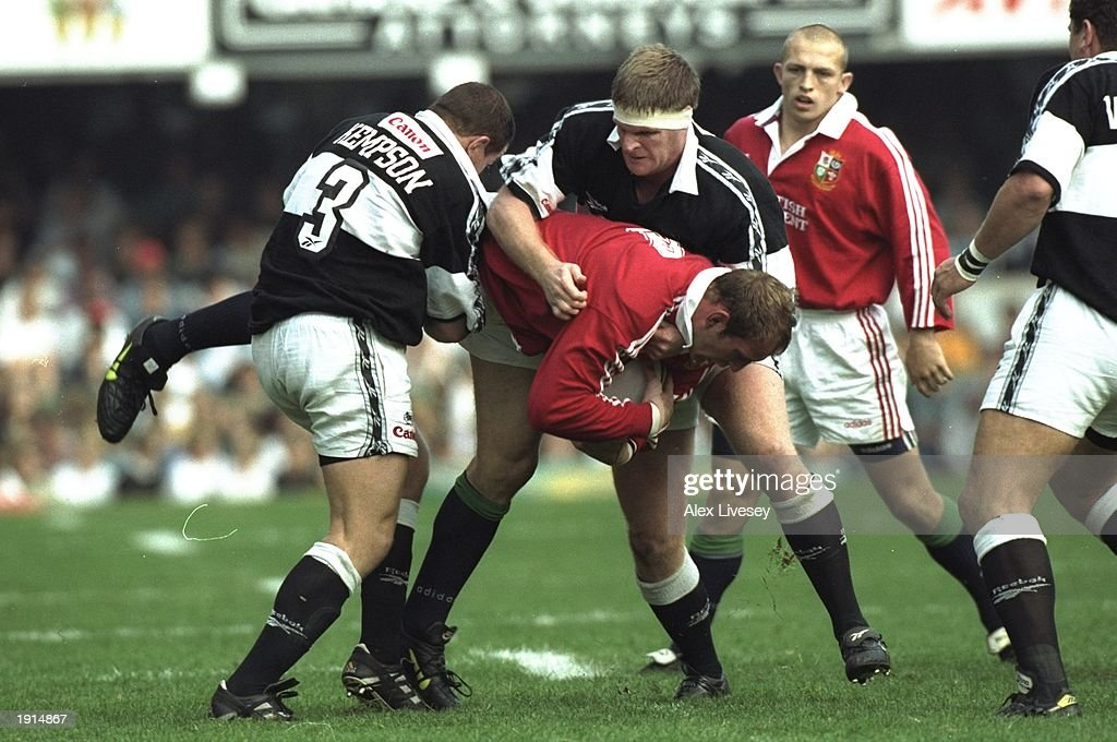 Lawrence Dallaglio of the British Lions is tackled during the match against Natal Sharks at Kings Park in Durban Natal South Africa The British Lions...