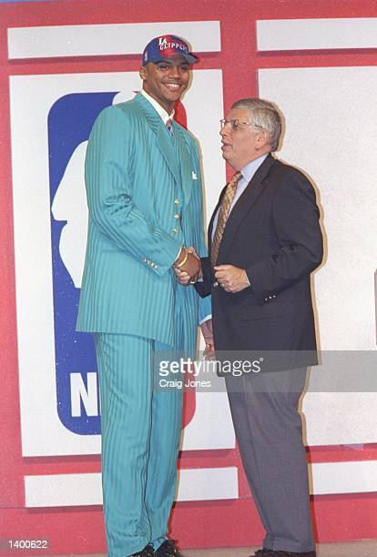 Maurice Taylor of the Los Angeles Clippers shakes hands with NBA Commissioner David Stern during the NBA Draft at the Charlotte Coliseum in Charlotte...