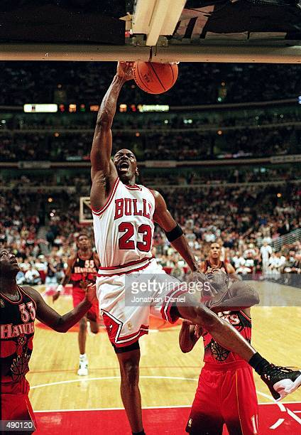 Michael Jordan of the Chicago Bulls dunks the ball during a game against the Atlanta Hawks at the United Center in Chicago Illinois The Bulls...