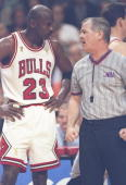 Michael Jordan of the Chicago Bulls talks to referee Joey Crawford during game 6 of the 1997 NBA Finals at the United Center in Chicago Illinois The...