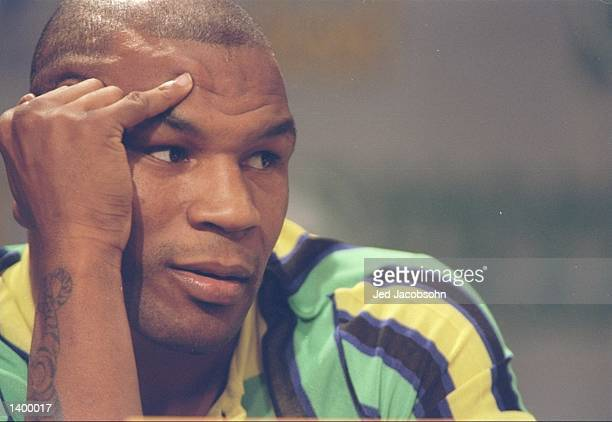 Mike Tyson looks on during a press conference before a bout against Evander Holyfield at the MGM Grand Garden in Las Vegas Nevada Holyfield won the...