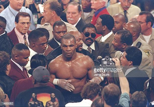 Mike Tyson makes his way back to the dressing room through the crowd after losing his heavyweight title fight against Evander Holyfield at the MGM...