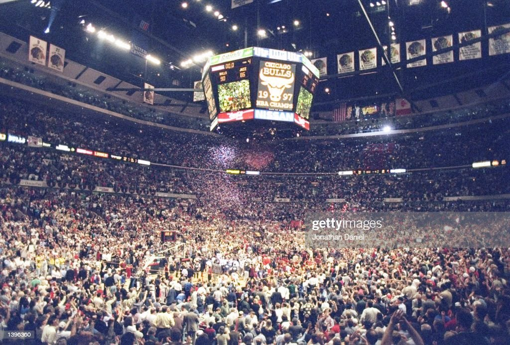 Players and fans converge on the floor of the United Center to celebrate after the Chicago Bulls defeat the Utah Jazz 9086 in game 6 to win the 1997...