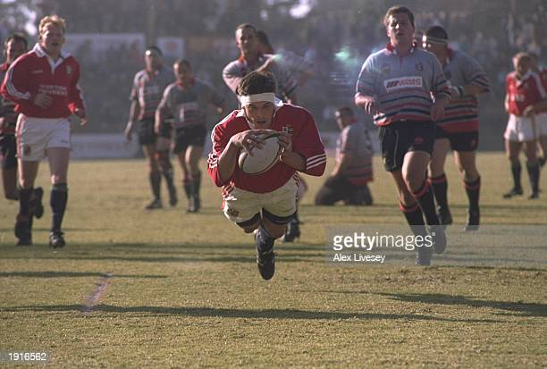 Rob Wainwright of the British Lions dives over the line to score a try during the tour match against Mpumalanga at the Jan van Riebeeck Stadium at...