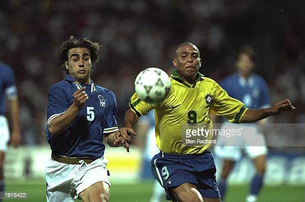 Ronaldo of Brazil competes with Fabio Cannavaro of Italy during the match in the Tournoi De France in Lyon France The game was drawn 33 Mandatory...