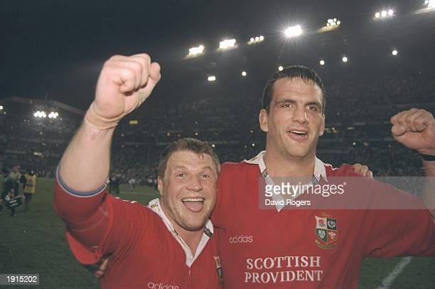 Scott Gibbs and Martin Johnson of the British Lions celebrate after defeating South Africa in the second test match at Kings Park in Durban South...