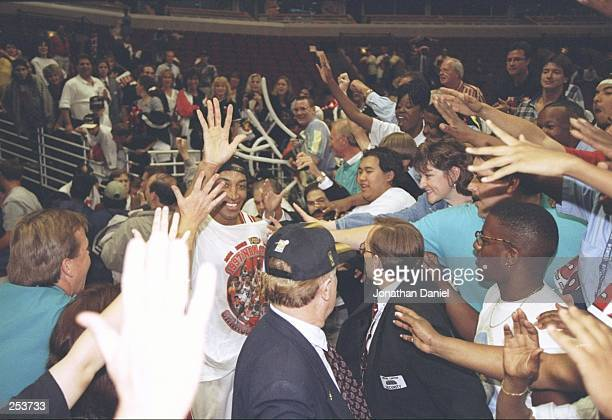 Scottie Pippen of the Chicago Bulls highfives fans as he celebrates after the Bulls win game 6 of the 1997 NBA Finals at the United Center in Chicago...