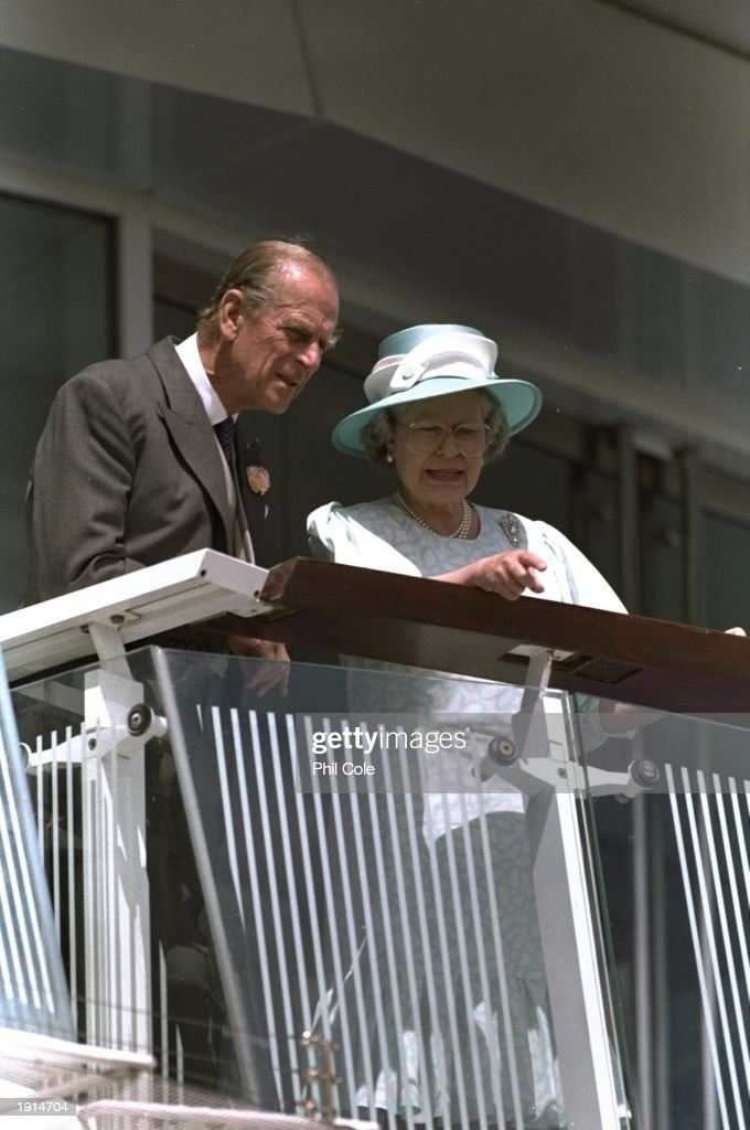 The Queen and the Duke of Edinburgh take in the atmosphere during the Vodafone Derby at Epsom Downs Racecourse in Surrey, England. \ Mandatory Credit: Phil Cole /Allsport