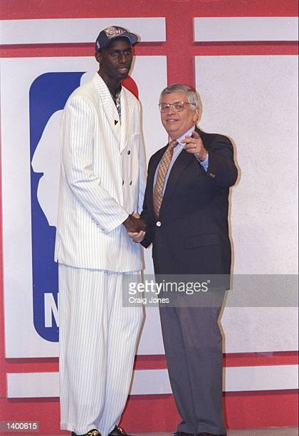 Tim Thomas of the New Jersey Nets shakes hands with NBA Commissioner David Stern during the NBA Draft at the Charlotte Coliseum in Charlotte North...