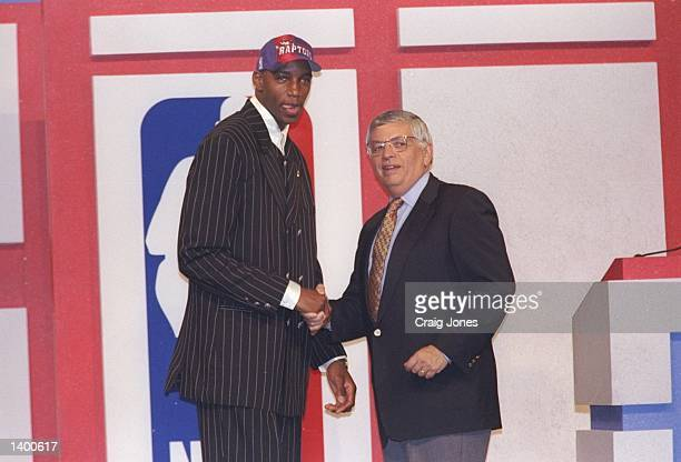 Tracy McGrady of the Toronto Raptors shakes hands with NBA Commissioner David Stern during the NBA Draft at the Charlotte Coliseum in Charlotte North...