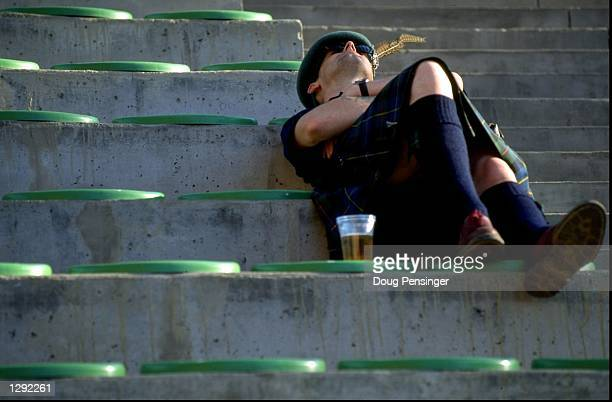 A Scotland fan catches some sleep before the World Cup group A game against Morocco at the Stade Goeffroy Guichard in St Etienne France Scotland lost...