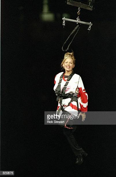 A woman is lowered from the rafters during a Stanley Cup Finals game between the Detroit Red Wings and the Washington Capitals at the Joe Louis Arena...