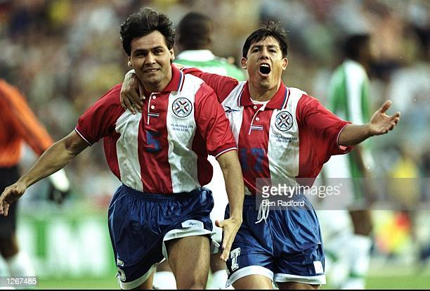 Celso Ayala of Paraguay celebrates with team mate Hugo Brizuela after scoring in the World Cup group D game against Nigeria at the Stade Municipal in...