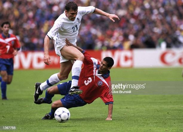 Chirstian Vieri of Italy skips past Ronald Fuentes of Chile during the World Cup group B game at the Stade Geoffroy Guichard in St Etienne France...