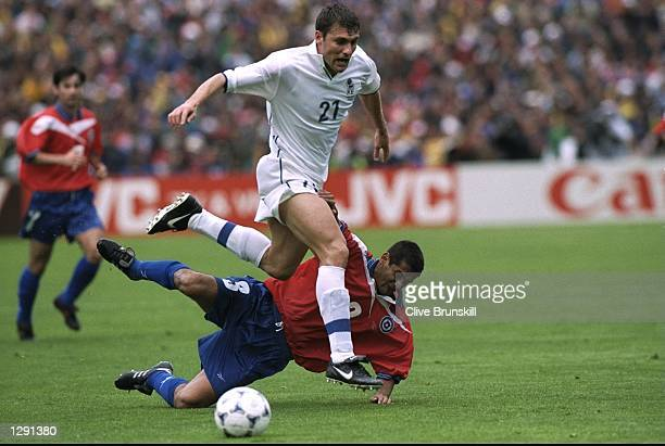 Christian Vieri of Italy skips past Ronald Fuentes of Chile during the World Cup group B game at the Parc Lescure in Bordeaux France Vieri scored the...