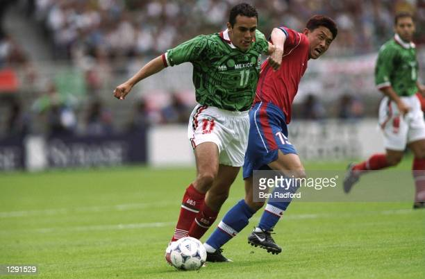 Cuauhtemoc Blanco of Mexico goes past Jang DaeIl of South Korea during the World Cup group E game at the Stade Gerland in Lyon France Mexico won 31...