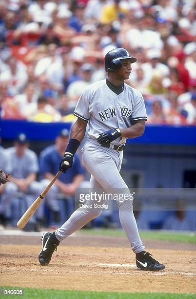 Darryl Strawberry of the New YorkYankees drops his bat during a Interleague game against the New York Mets at Shea Stadium in Flushing New York The...