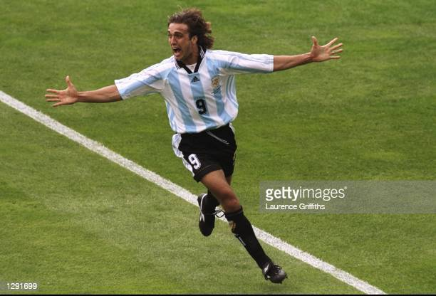Gabriel Batistuta of Argentina celebrates after scoring in the World Cup group H game against Japan at the Stade Municipal in Toulouse France...
