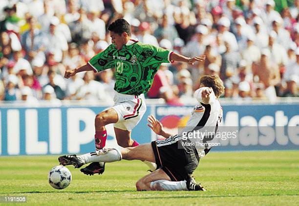 Jesus Arellano of Mexico takes the ball past Christian Worns of Germany during the FIFA World Cup Finals 1998 second round match played in...