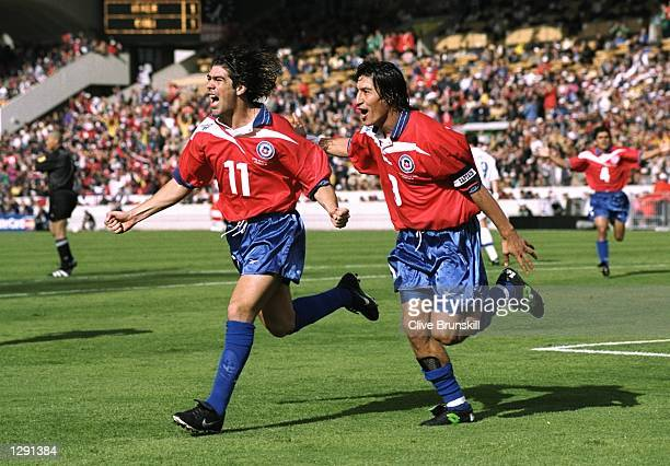 Marcelo Salas of Chile celebrates with team mate Ivan Zamorano after scoring in the World Cup group B game against Italy at the Parc Lescure in...