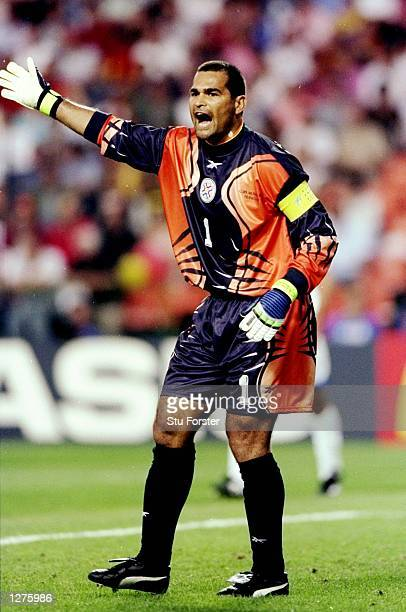 Paraguay goalkeeper JoseLuis Chilavert directs his team mates during the World Cup first round match against Spain at the Stade GeoffroyGuichard in...