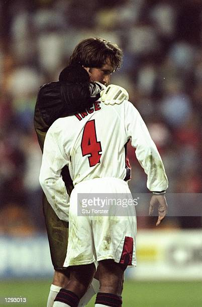 Paul Ince of England is consoled by team mate David Seaman after seeing his penalty saved during the shootout in the World Cup second round match...