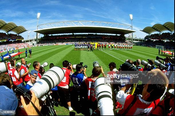 Photographers shoot the lineups before the World Cup group C game between France and Denmark at the Stade Gerland in Lyon France Mandatory Credit...