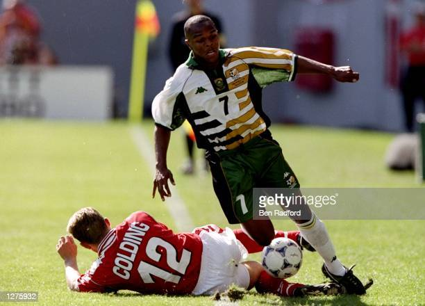 Quinton Fortune of South Africa is tackled by Soren Colding of Denmark during the World Cup first round match at the Stade Municipal in Toulouse...