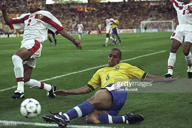Roberto Carlos of Brazil slides in during the World Cup group A game against Morocco at the Stade de la Beaujoire in Nantes France Mandatory Credit...